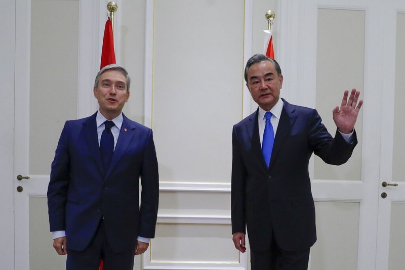 Canadian Foreign Minister François-Philippe Champagne, left, and Chinese Foreign Minister Wang Li, pose for photographers on the occasion of th...