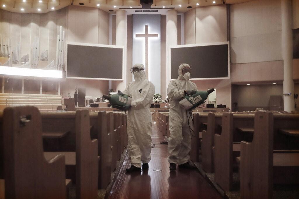 Officials disinfectYoido Full Gospel Church in Seoul, South Korea.