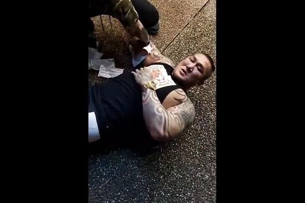 Holger Chen falls to ground after being shot. (Facebook, Holger Chen screenshot)