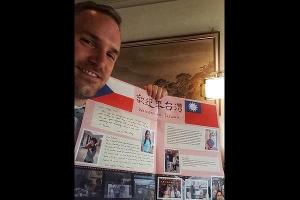 Zdenek Hrib poses with card given by classmates. (Facebook, Hrib photo)