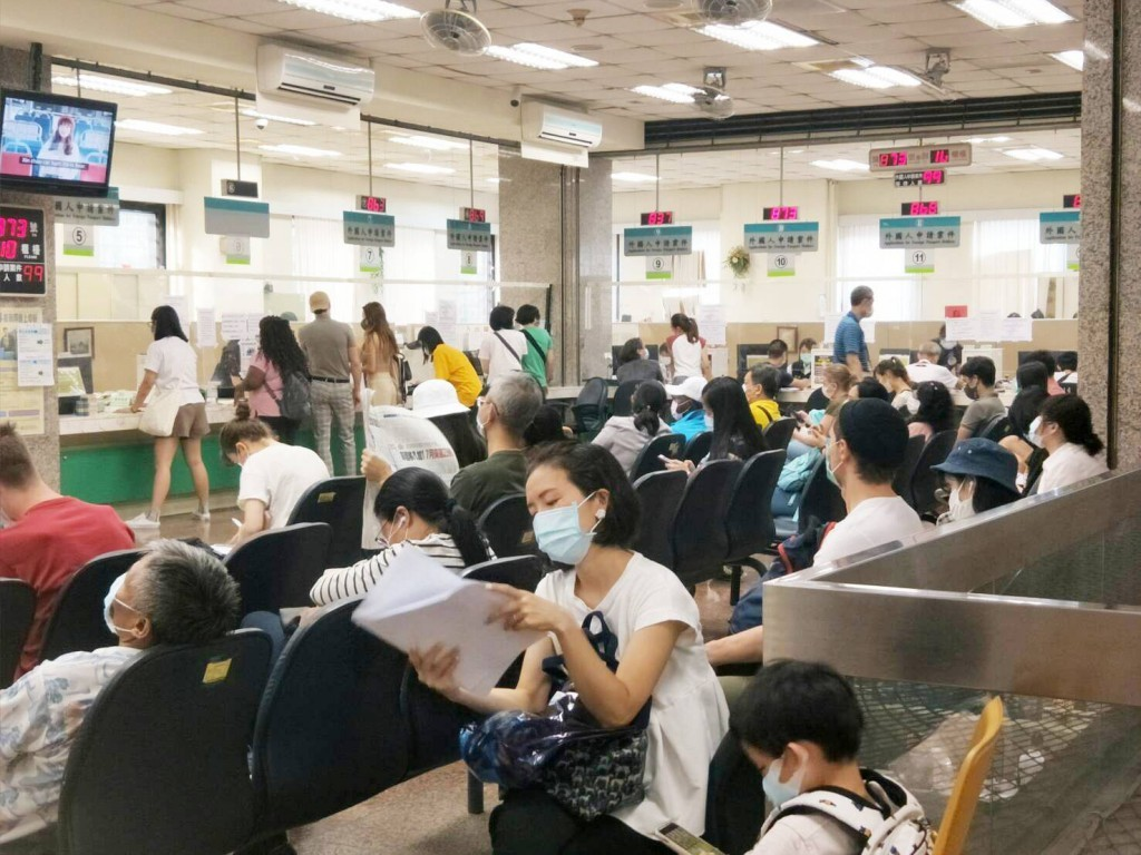 Foreign nationals waiting in NIA service center to apply for visas. (NIA photo)