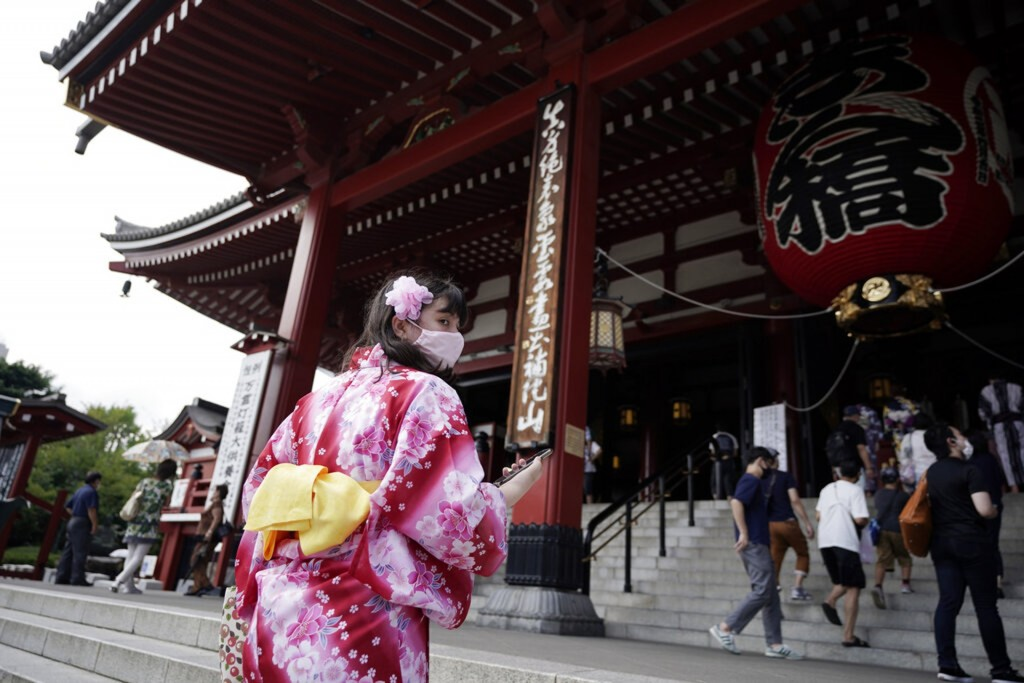 Visitor wears mask at shopping arcade in Tokyo's Asakusa district.