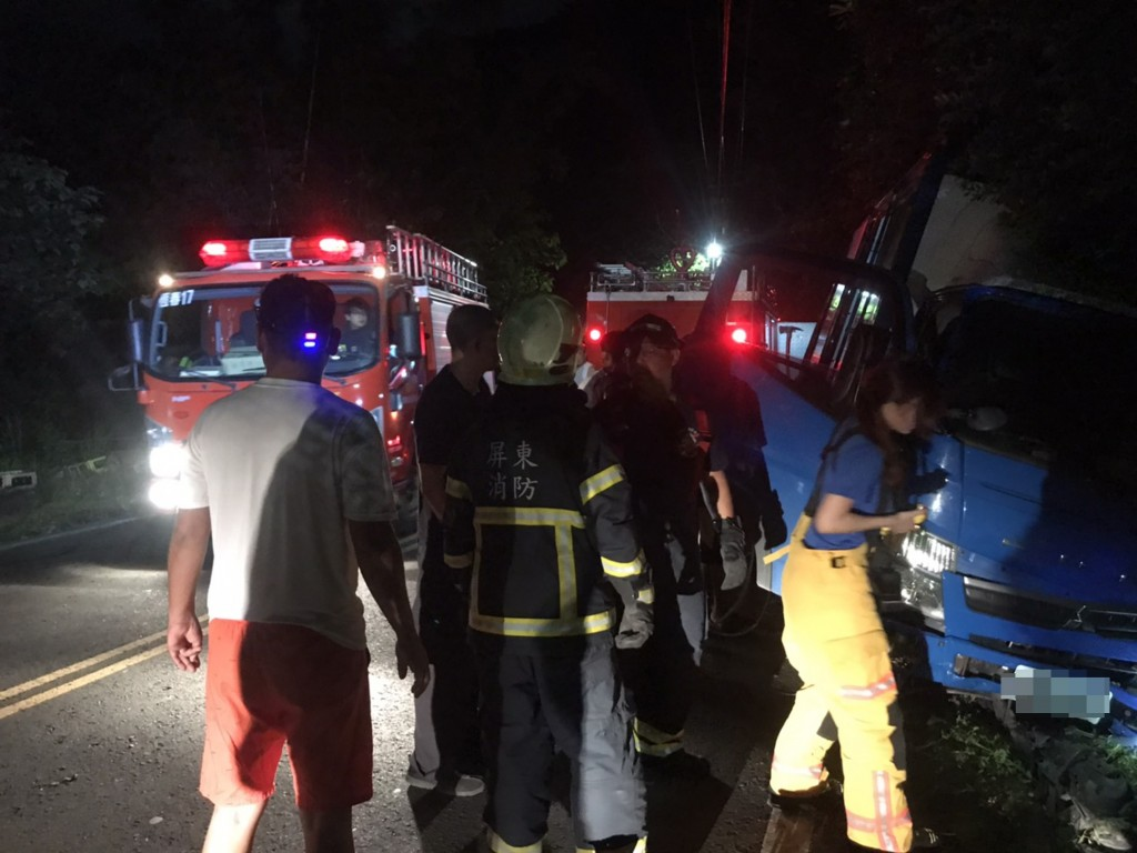 Rescue workers at the scene of the accident in Manzhou Friday (Sept. 4) evening