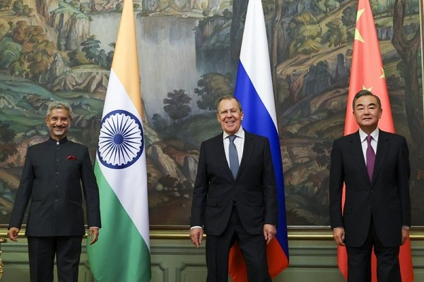 India's Foreign Minister S. Jaishankar (left), Russia's Foreign Minister Sergey Lavrov, and China's Foreign Minister Wang Yi, pose for a p...