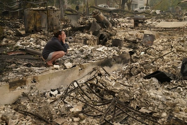 Desiree Pierce cries as she visits her home destroyed by the Almeda Fire, Friday, Sept. 11, 2020, in Talent, Ore.