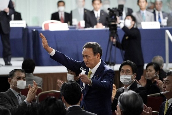 Japanese Chief Cabinet Secretary Yoshihide Suga acknowledges as he is elected as new head of Japan's ruling party at the Liberal Democratic Party&...