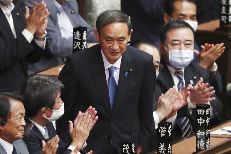 Yoshihide Suga is applauded after being elected as Japan's new prime minister Sept. 16, 2020.