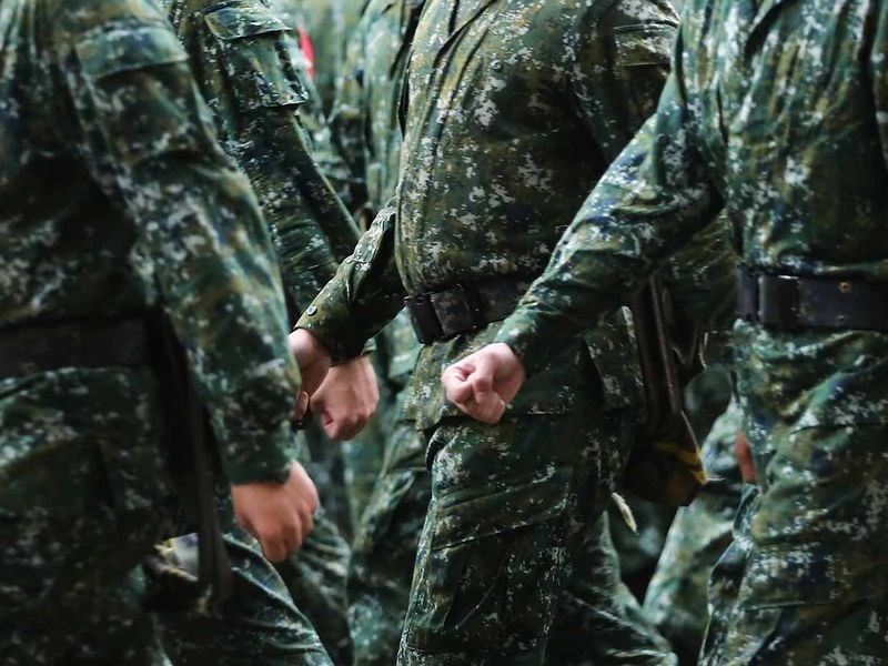 Taiwan's military considers restoring year-long mandatory service and including women in armed forces.