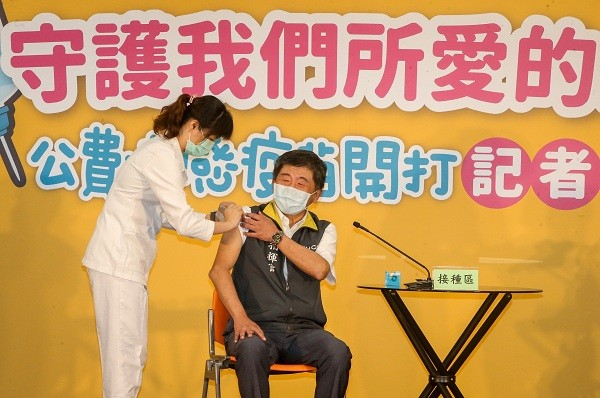 Taiwanese people line up to get government-funded flu vaccines