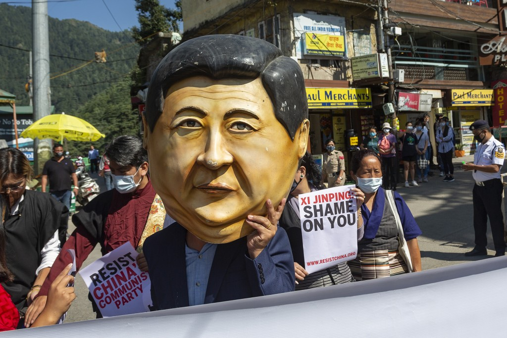 Exile Tibetan representing Xi Jinping marches with others duringstreet protest in Dharmsala, India, Thursday, Oct. 1, 2020.