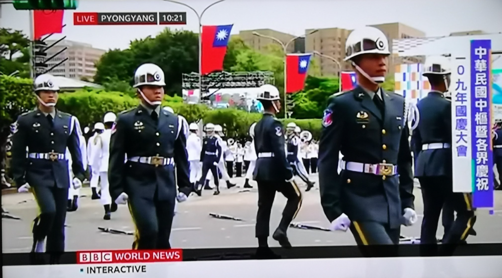 """BBC footage of the Double Ten parade with the words """"Live Pyongyang."""" (Twitter, LazyWorkz photo)"""
