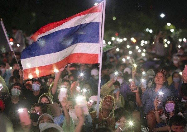 Pro-democracy protesters wave flag during protest at Sanam Luang in Bangkok on Sept. 19, 2020.