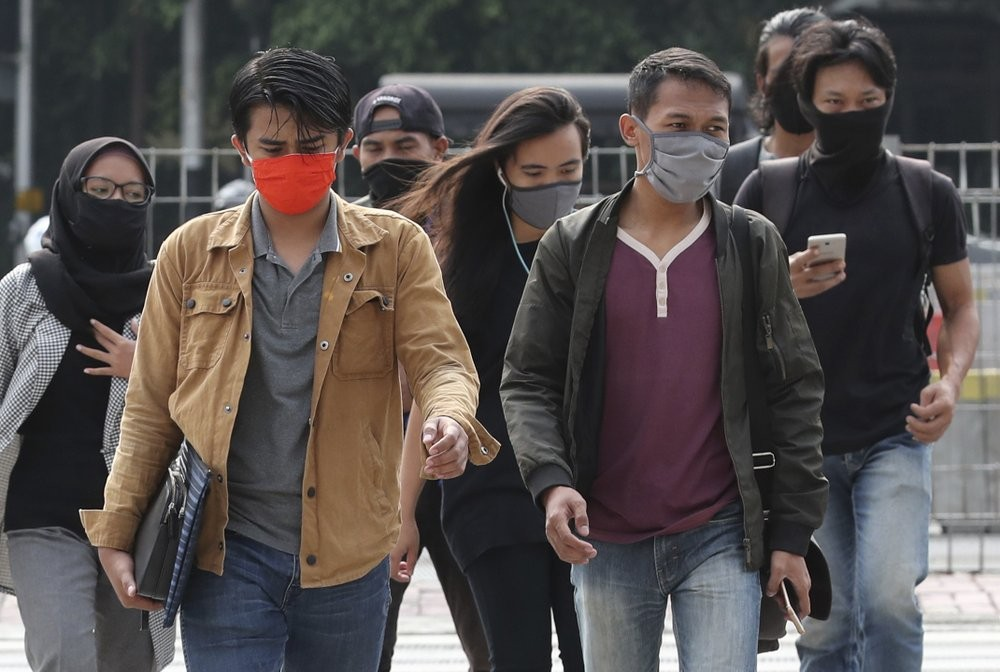 Young people wearing masks in Jakarta, Indonesia