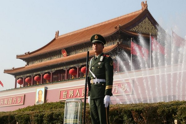 Chinese solider standing in Tiananmen Square in Beijing.