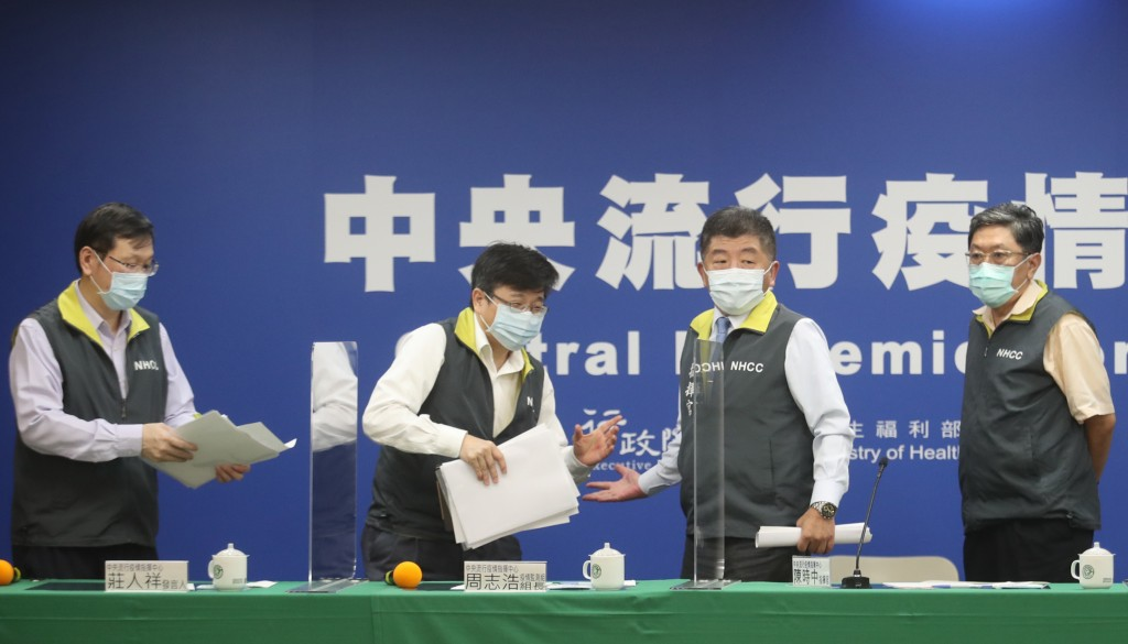 CECC chief Chen Shih-chung (second from right) prepares a new package of measures against the COVID-19 pandemic