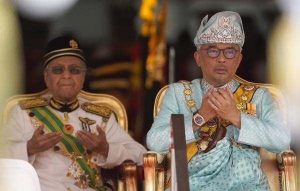 Malaysia's King Al-Sultan Abdullah (right).