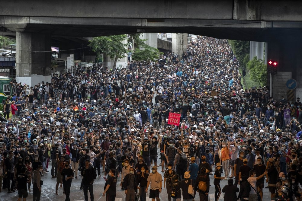 Pro-democracy protesters march during a protest in Udom Suk, suburbs of Bangkok, Thailand, Saturday, Oct. 17, 2020. The authorities in Bangkok shut do...