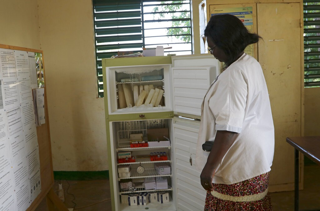 A nurse at the health clinic in Zeguedessin village on the outskirts of Burkina Faso's capital, Ouagadougou, opens the fridge where the clinic kee...