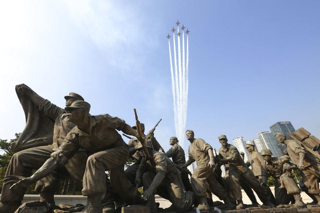 South Korea's Black Eagles aerobatic flight team performs over Korean War monument during rehearsal for Changjin Lake Battle memorial day.