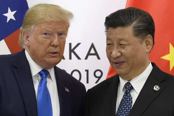 U.S. President Donald Trump poses for a photo with Chinese Secretary GeneralXi Jinping during a meeting.