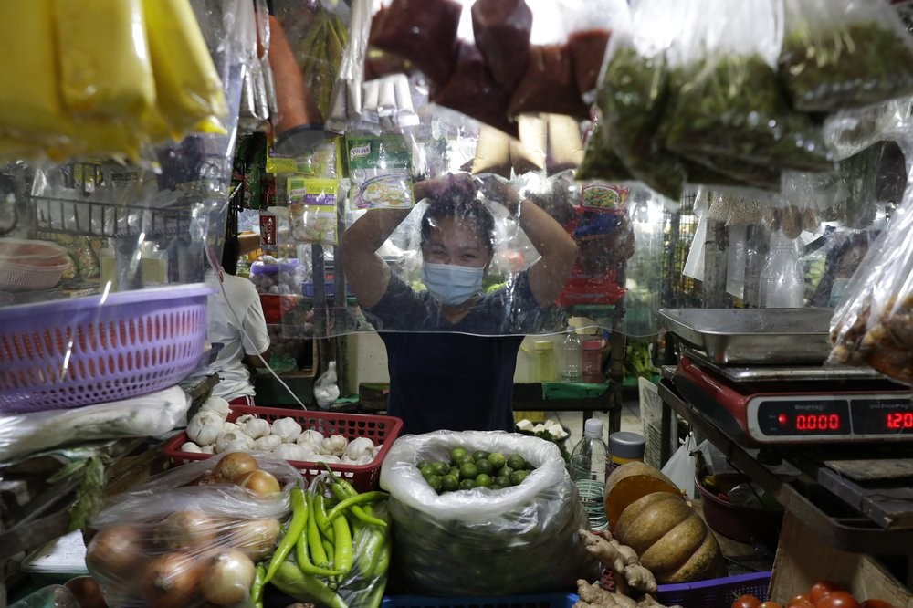 Plastic sheets to protect against the coronavirus at a market in Quezon City, Philippines
