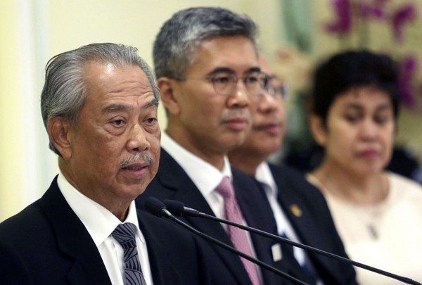 MalaysianPrime Minister Muhyiddin Yassin (left).