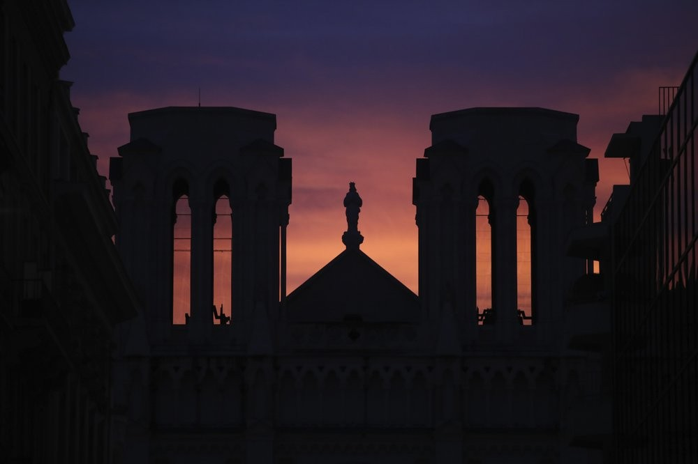 The sun sets behind the Notre Dame church in Nice, southern France, after a knife attack took place on Thursday, Oct. 29, 2020.