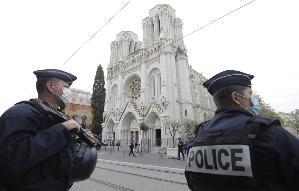 Police officers stand guard near Notre Dame church in Nice, southern France, Thursday, Oct. 29, 2020.