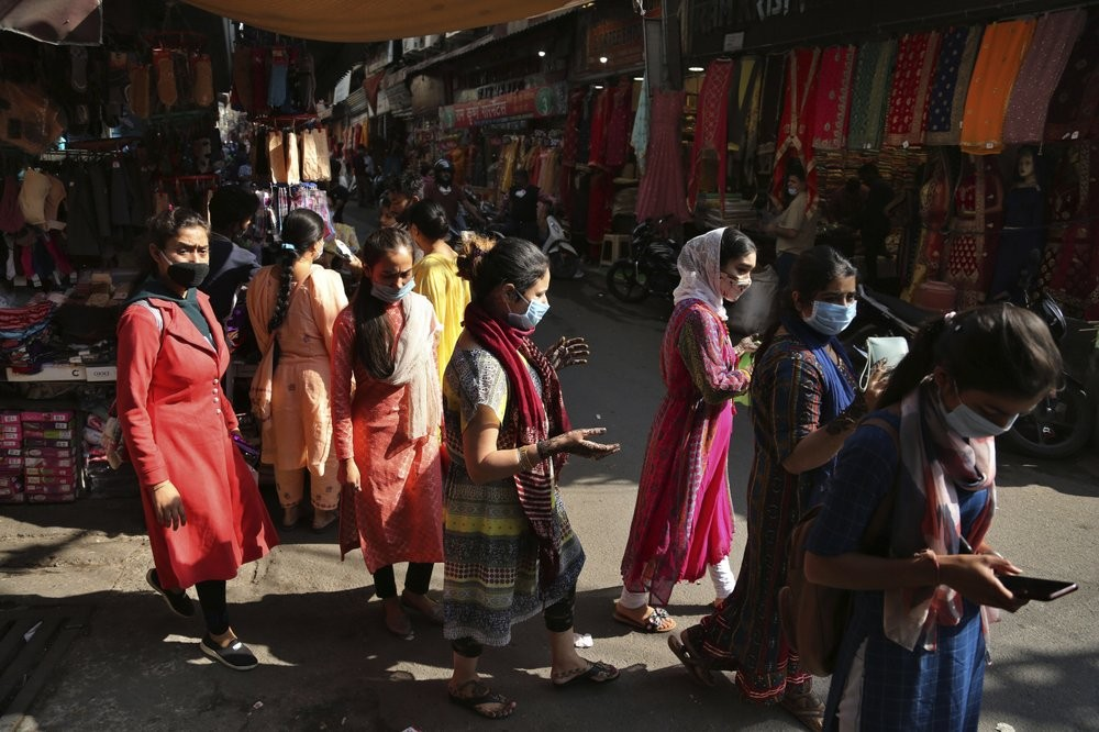 Shoppers wearing masks at market in Indian state of Jammu.
