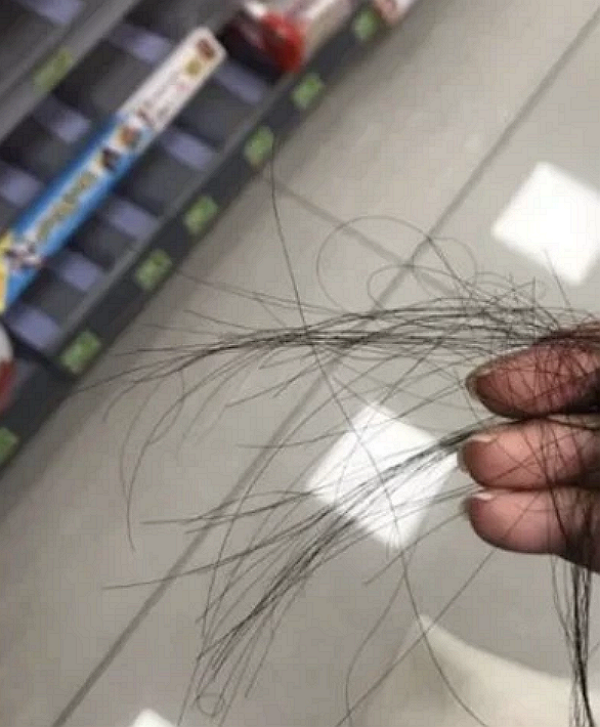 Taipei police arrest college student for cutting woman's hair