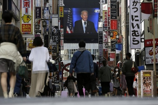 A screen shows a broadcast of President-elect Joe Biden speaking Sunday, Nov. 8, 2020 at the Shinjuku shopping district in Tokyo.