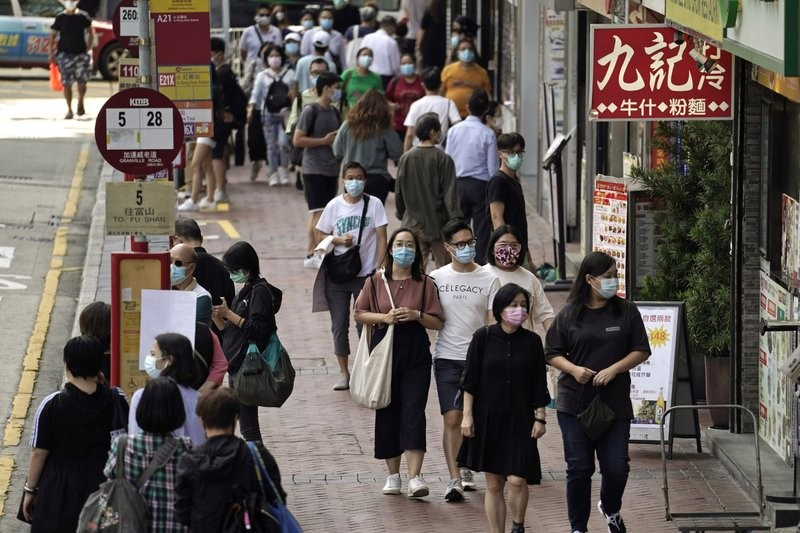 Masked shoppers in the streets of Hong Kong in October