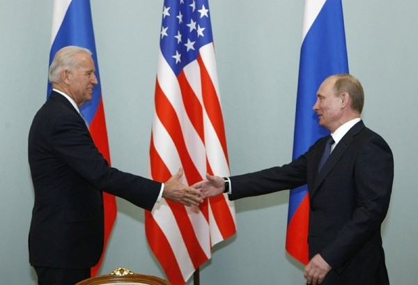 U.S. President-elect Joe Bidenshakes hands with Russian Prime Minister Vladimir Putin in Moscow, Russia during a meeting in 2013.