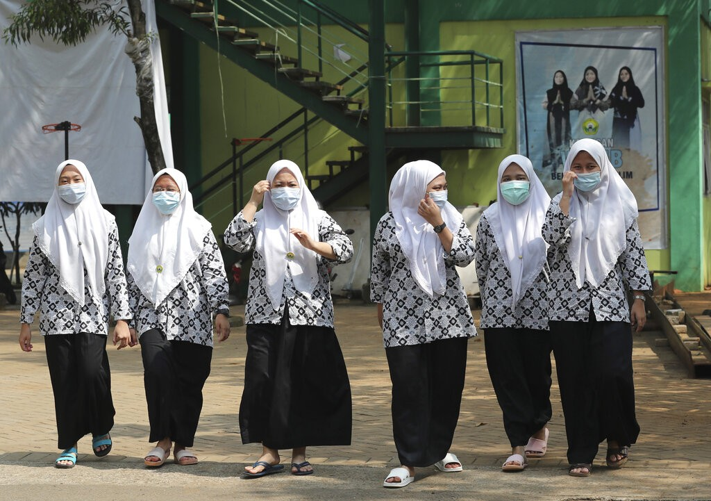 Students wear face masks to curb the spread of coronavirus outbreak at the Daarul Rahman Islamic Boarding School in Jakarta, Indonesia.
