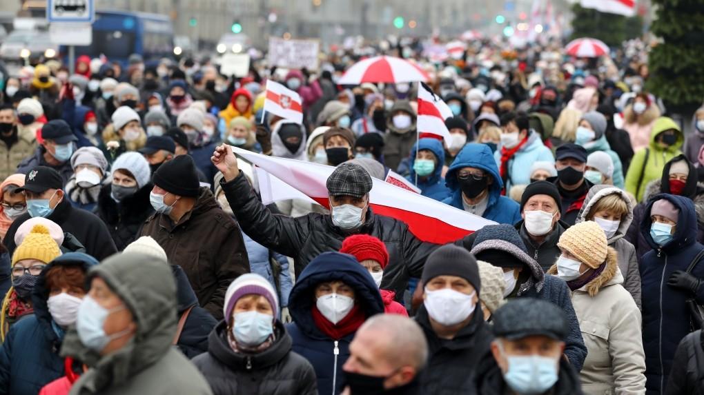 Belarusians wearing surgical masks attend an opposition rally in Minsk, Belarus.