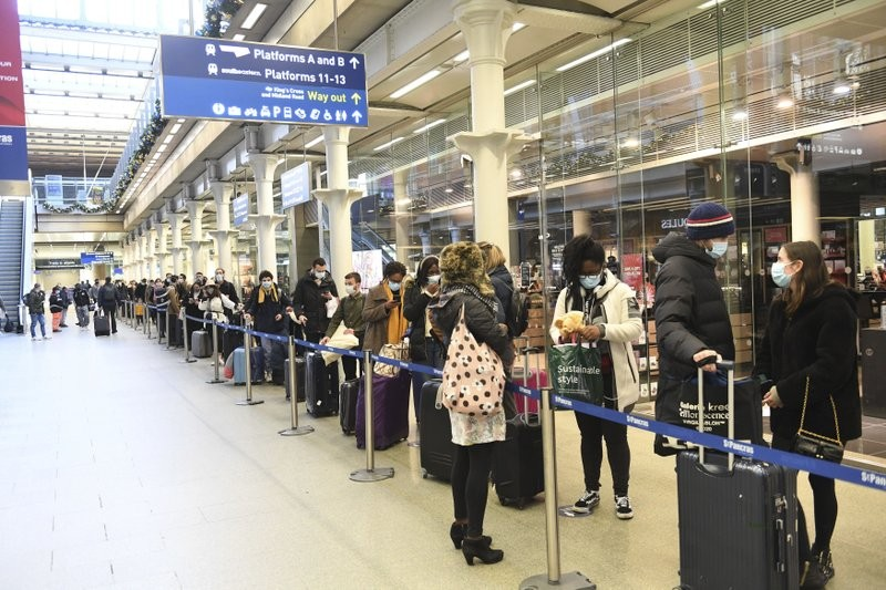 People at St Pancras station in London, wait to board the last train to Paris Dec. 20, 2020.