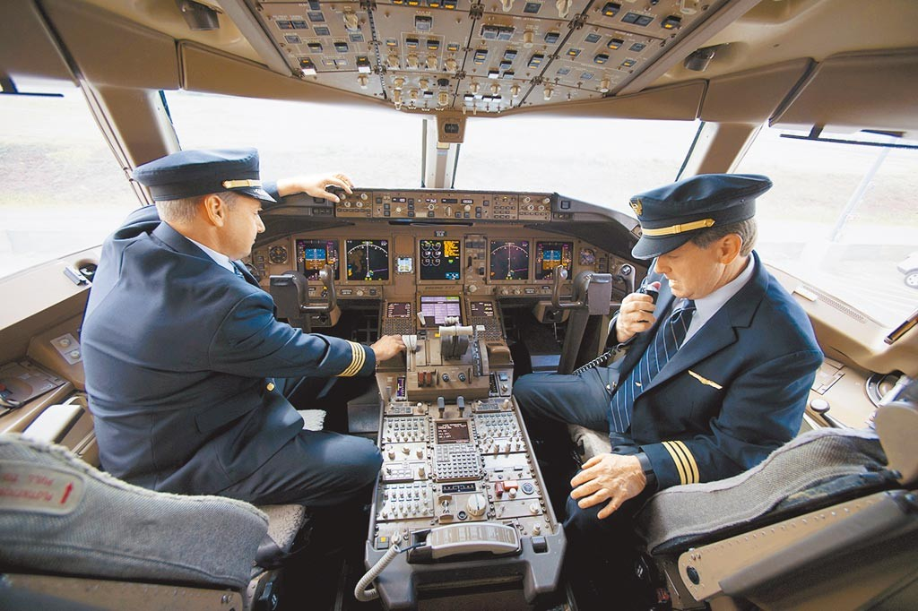 Stock image of pilots in a cockpit.