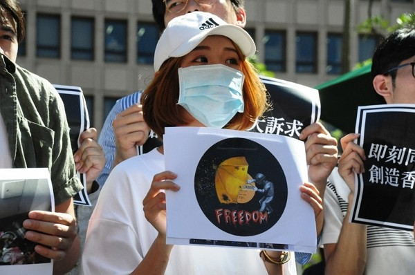 A student advocates for freedom in Hong Kong during pro-democracy rally in Taipei.