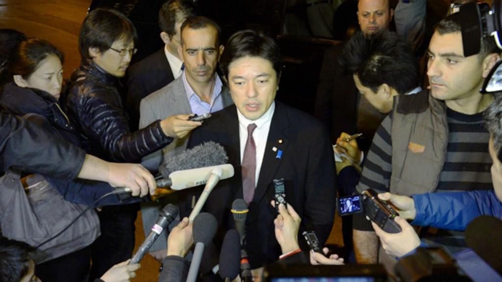Japan's deputy defense minister, Yasuhide Nakayama (center)