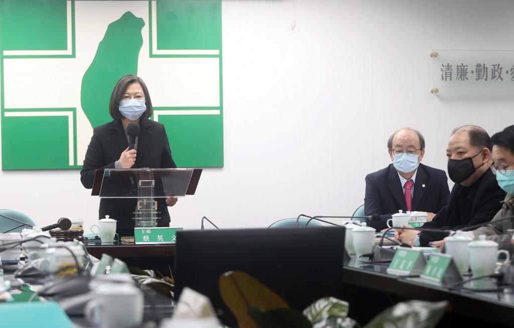 President Tsai Ing-wen (left) speaking at the DPP headquarters Wednesday
