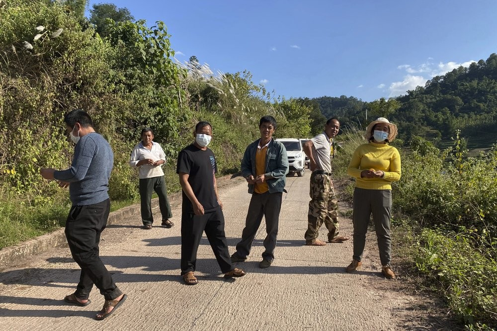 A group claiming to be local villagers blocks access to a bat cave in Yunnan Province, China