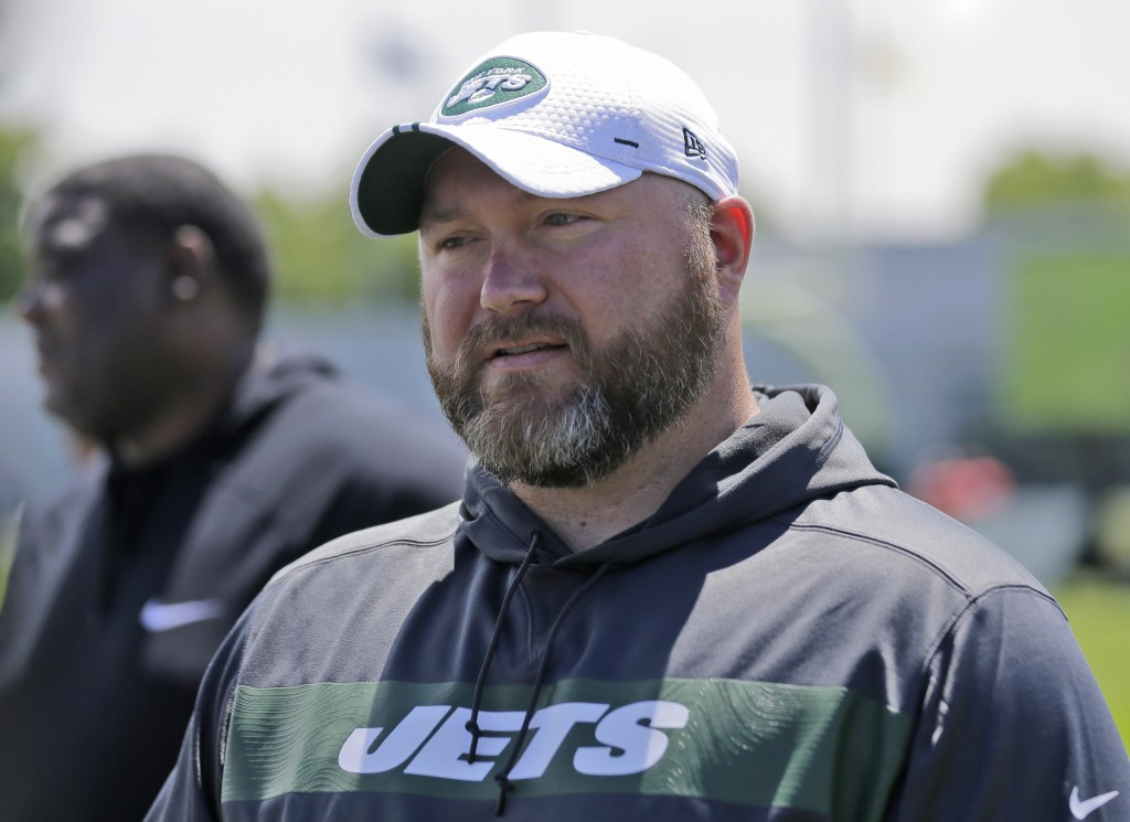 FILE - In this Tuesday, June 11, 2019 file photo, New York Jets general manager Joe Douglas greets reporters during a practice at the team's NFL footb...