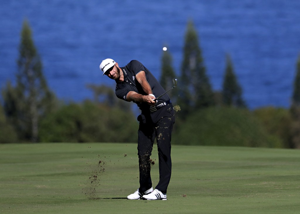 FILE - In this Jan. 7, 2017, file photo, Dustin Johnson hits for the fourth fairway during the third round of the Tournament of Champions golf event a...