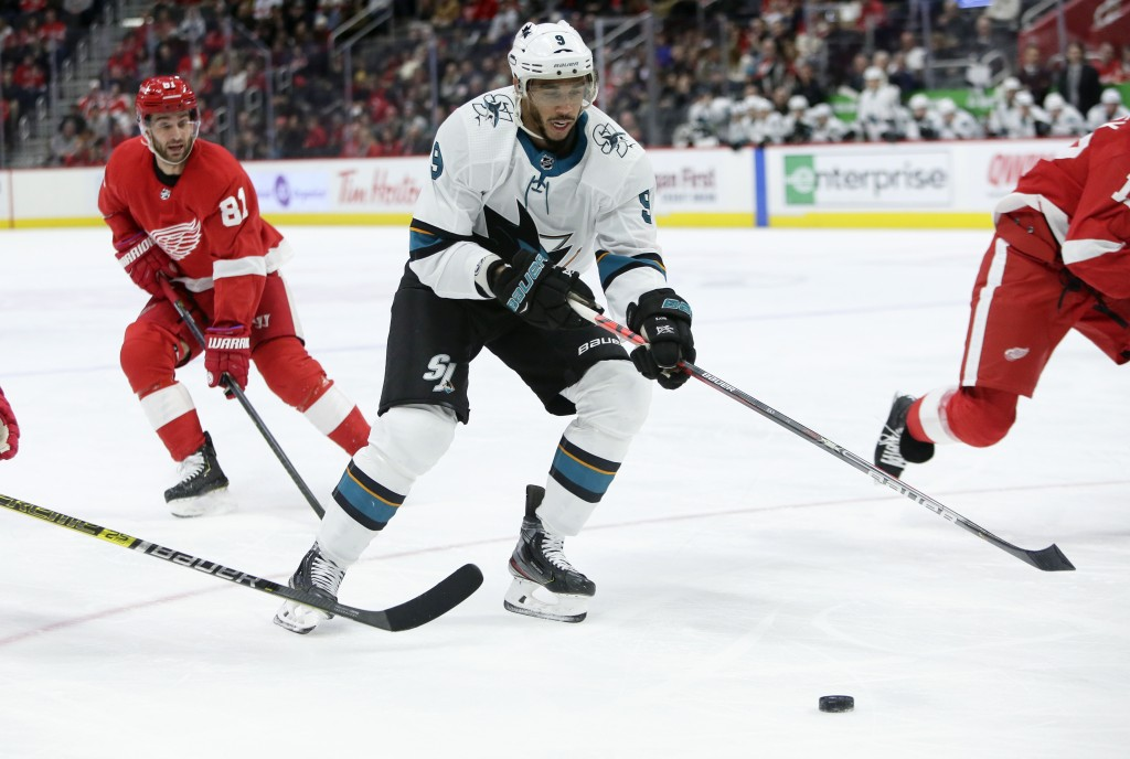 San Jose Sharks left wing Evander Kane (9) looks to pass the puck while being pursued by Detroit Red Wings center Frans Nielsen (81), of Denmark, duri...
