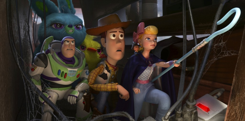 This image released by Disney shows, foreground from left, Buzz Lightyear, voiced by Tim Allen, Woody, voiced by Tom Hanks and Bo Peep, voiced by Anni...