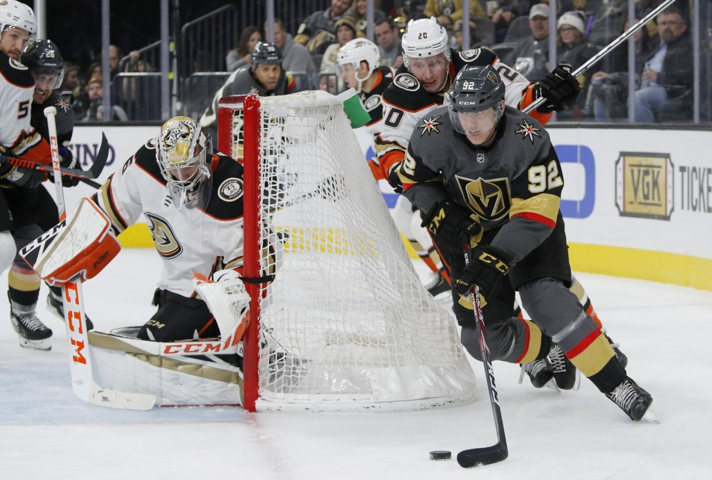 Vegas Golden Knights left wing Tomas Nosek (92) skates around Anaheim Ducks left wing Nicolas Deslauriers (20) during the second period of an NHL hock...