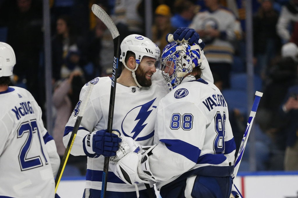Tampa Bay Lightning forward Pat Maroon (14) and goalie Andrei Vasilevskiy (88) celebrate the team's 6-4 victory over the Buffalo Sabres in an NHL hock...