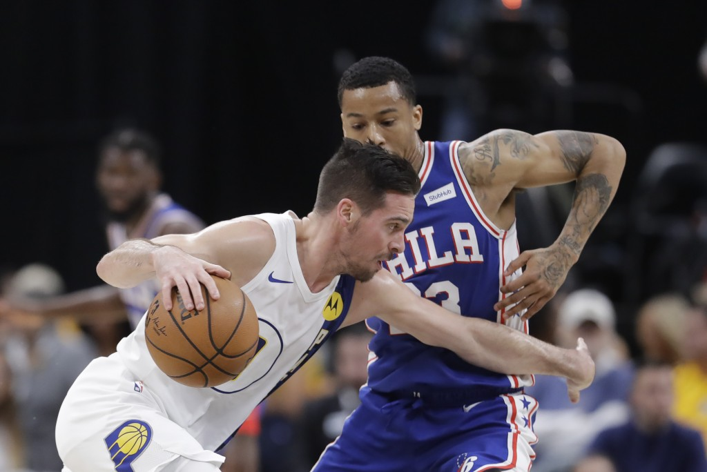 Indiana Pacers' T.J. McConnell (9) is defended by Philadelphia 76ers' Trey Burke (23) during the second half of an NBA basketball game, Tuesday, Dec. ...