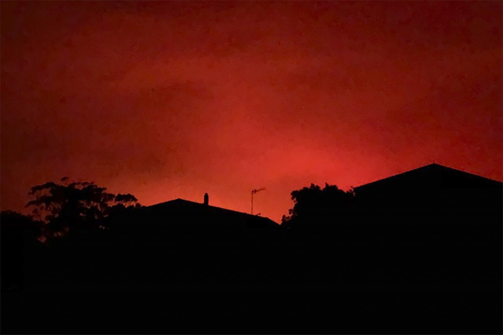 This Tuesday, Dec. 31, 2019, photo provided by Twitter user @AvaTheHuman shows red sky from wildfires burning, in Victoria, Australia. On Tuesday morn...
