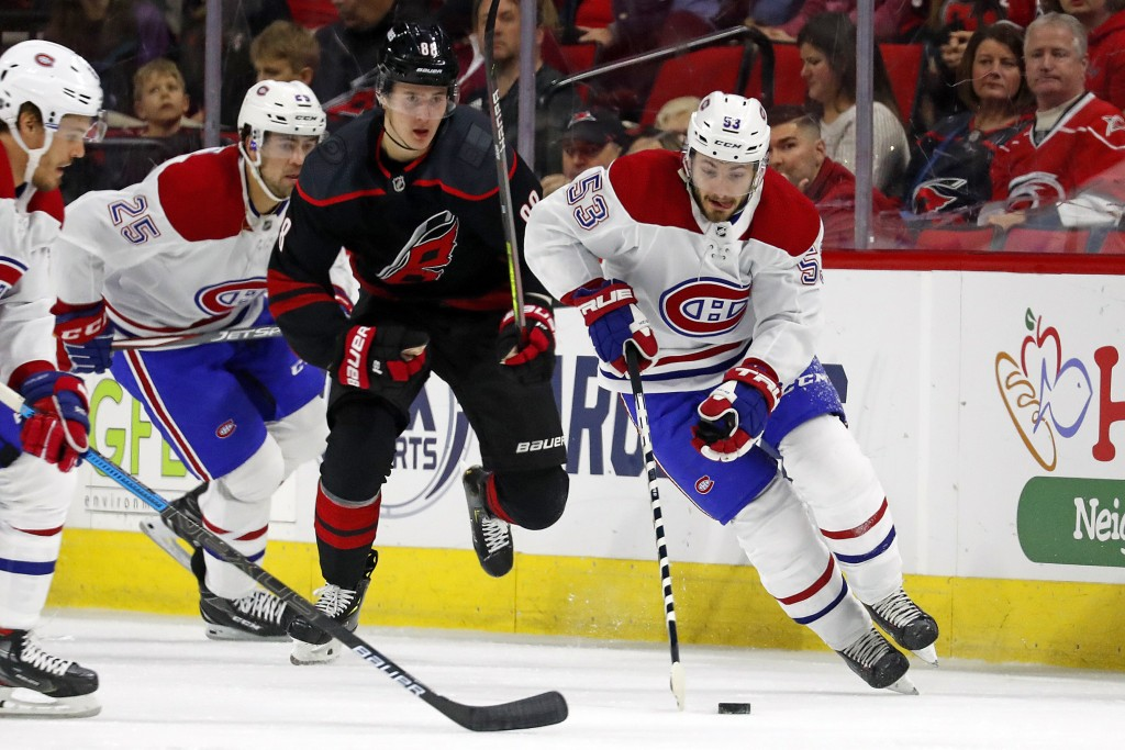 Montreal Canadiens' Victor Mete (53) brings the puck up the ice after taking it away from Carolina Hurricanes' Martin Necas (88), of the Czech Republi...